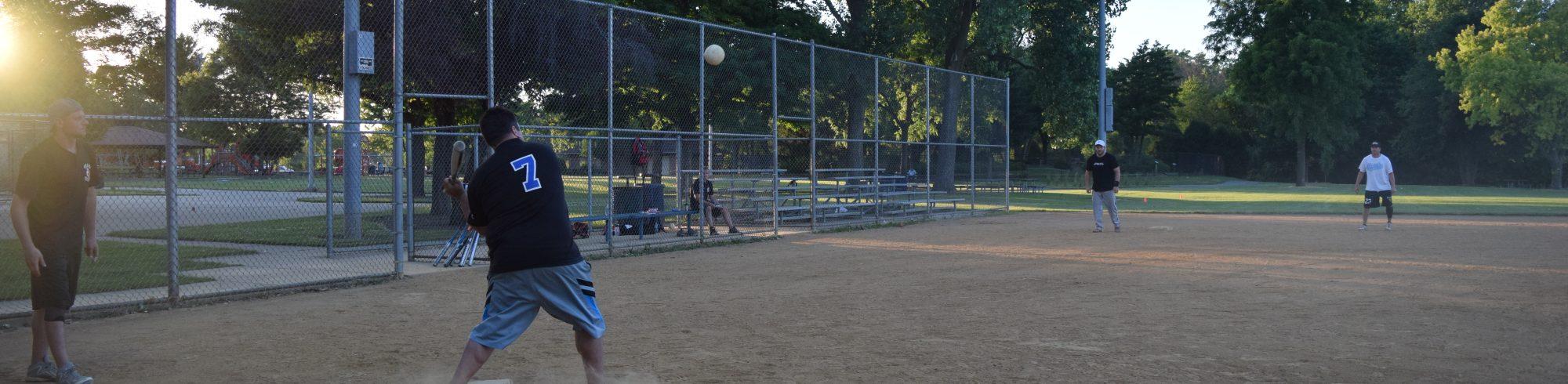 adults playing softball