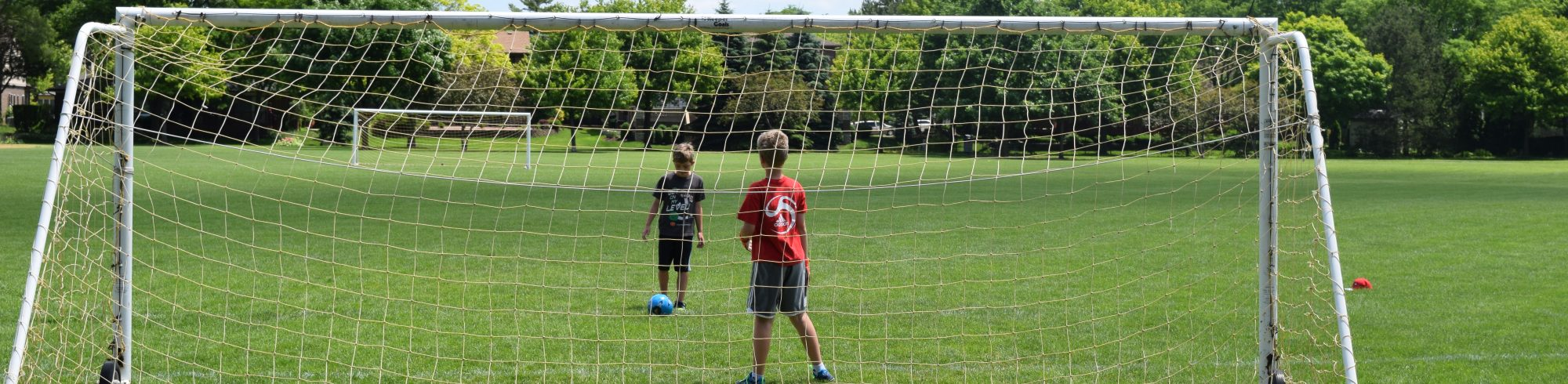 kids playing outdoor soccer