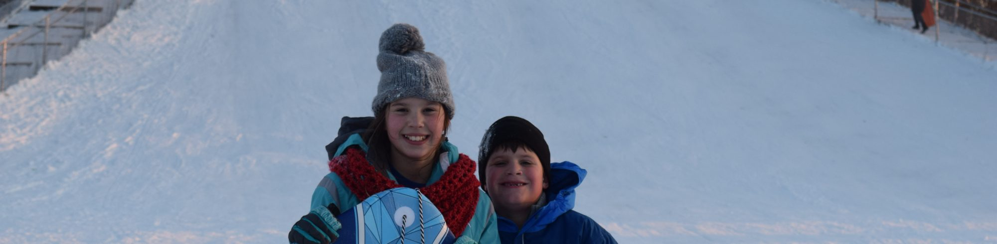 kids on sled hill