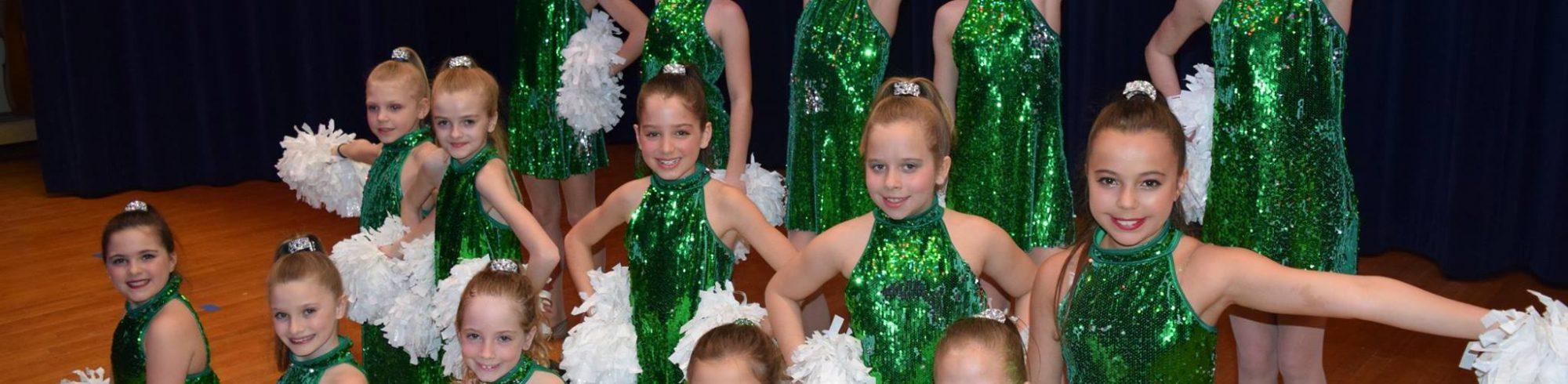girls performing poms