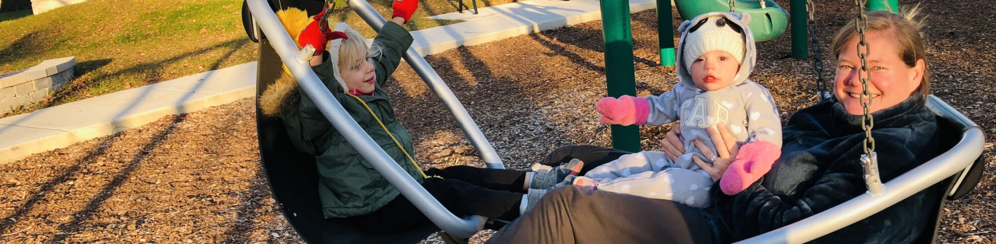 picture of family on swings